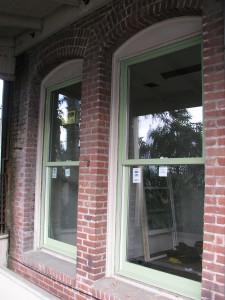 Marvin Hampton Sage Clad Ultimate Insert Double Hung Window in Brick Facase