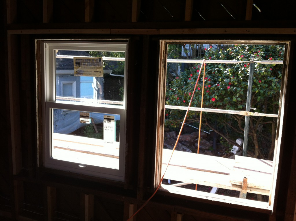 Marvin Clad Insert Double Hung Installed in Left Opening. Original Double Hung Window Without Sashes on the Right