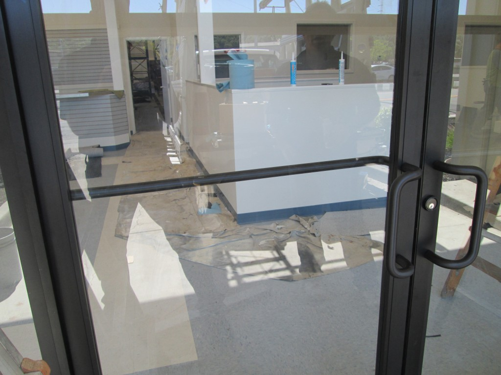 "Storefront Door Push Bar Seen Through 1/4"" Clear Tempered Glass"