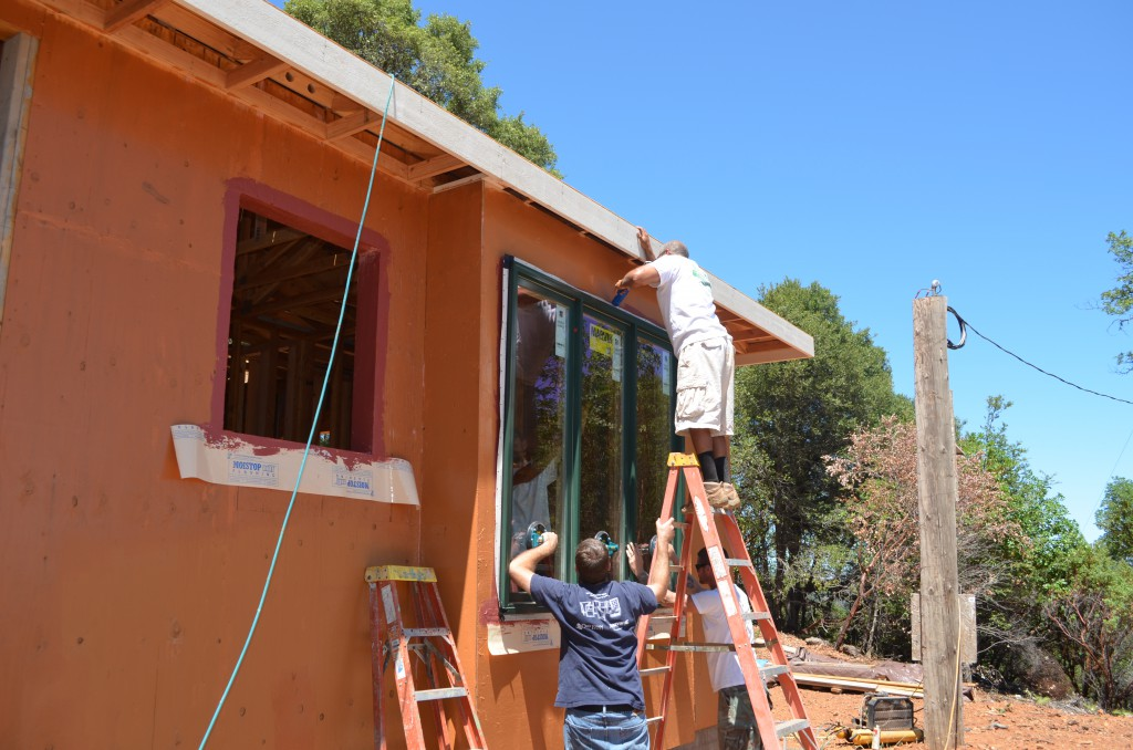 Crew Installing - Marvin Evergreen Clad Window with Clad Brick Mold Casing and Aluminum Nailing Flange.  Installed with Prosoco Cat5 Wall Coating, Fast Flash, and Joint and Seam