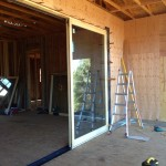 Installation of a Lift and Slide Door from Marvin.  Photo shows the exterior view of the fixed panel, prior to installation of the other three panels