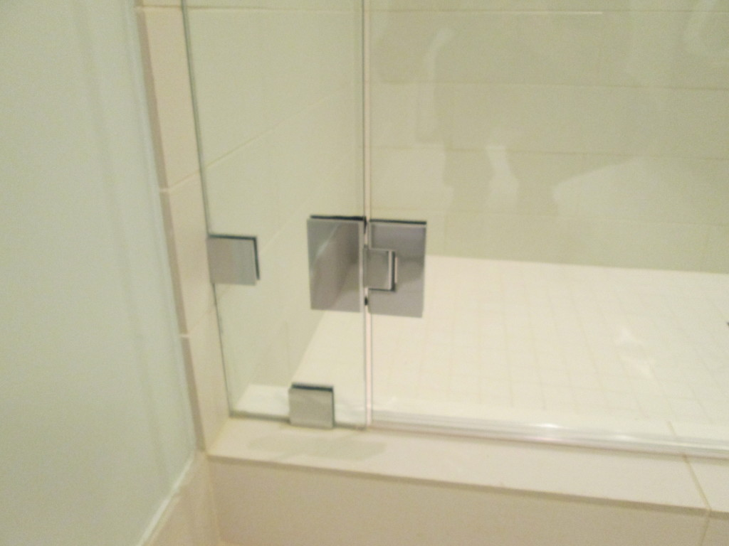 crl geneva shower door hardware in polished chrome used on a glass to glass installation - Glass Shower Door Hardware