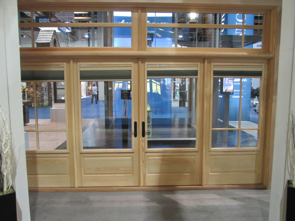 Marvin Clad Swinging French Door with a Raised Panel.  Shows Interior Shades in the open position.