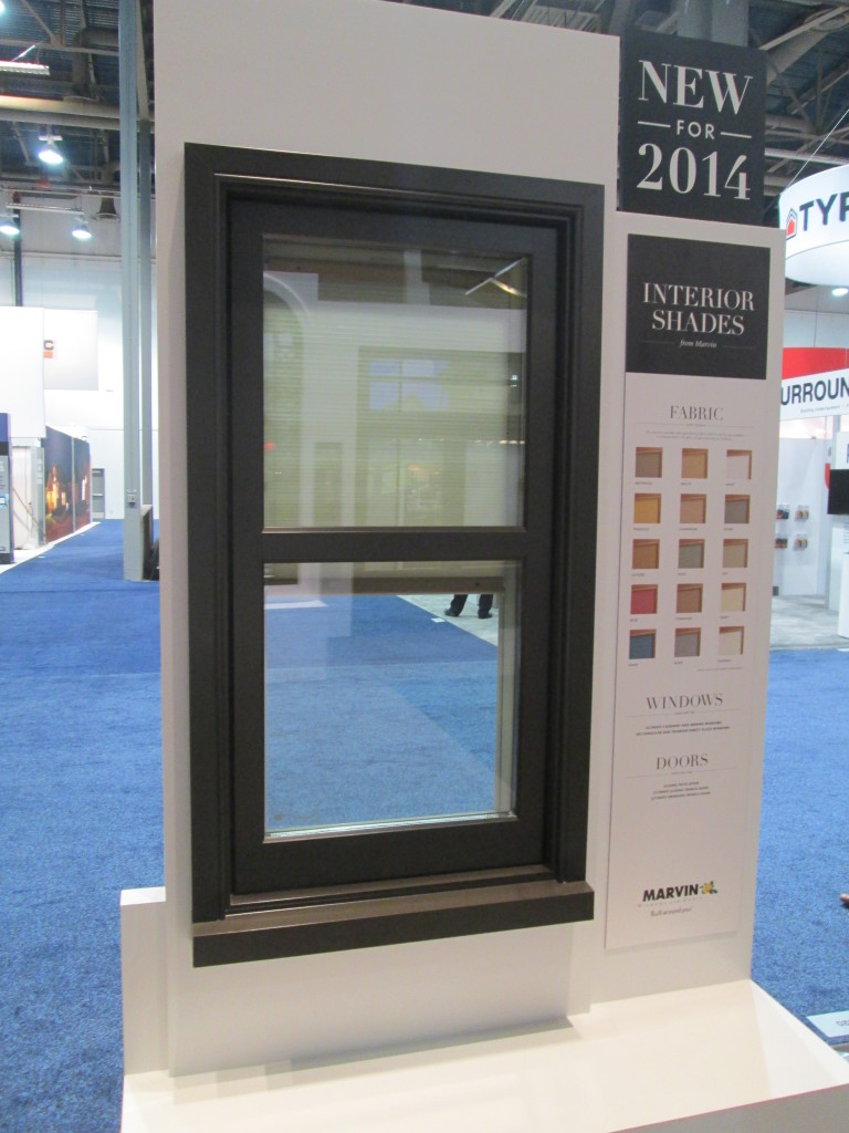 Exterior view of a Marvin Window with their new interior shade.