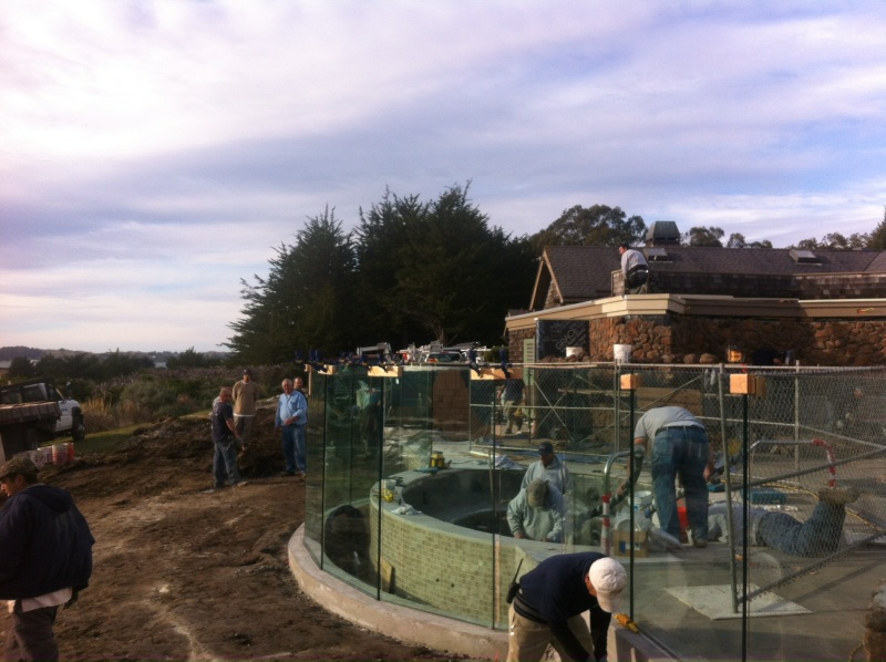 Installation of Glass Pool Fence in Bodega Bay around a Pool and Spa.  Curved Wall with Segmented Glass