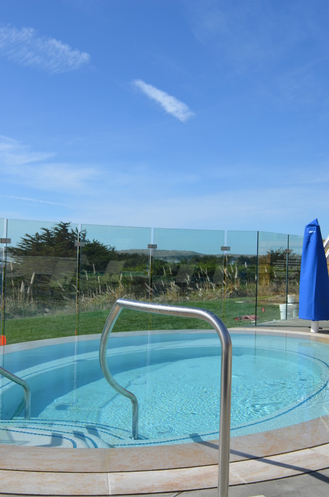 View of the Glass Railing with the Pool In Front