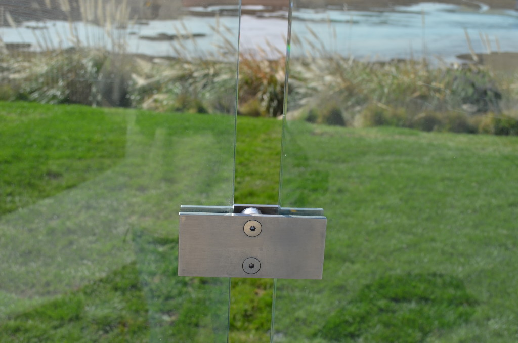 Stainless Steel Custom Fabricated Glass Clamp on Pool Fence