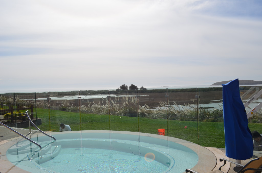 View of Bodega Bay and Doran Beach through glass fence