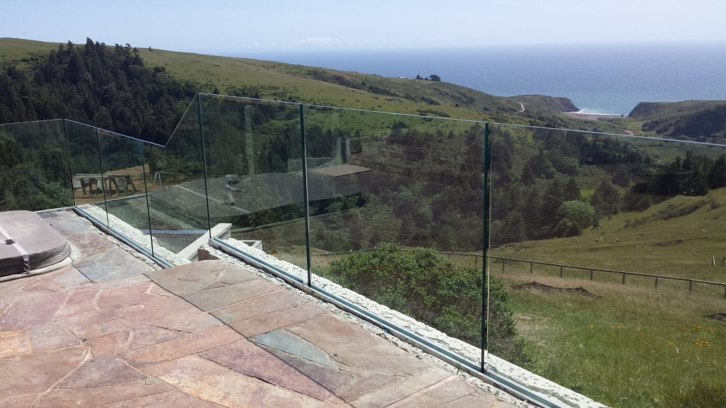 "Close up of the 27/32"" Tempered Laminated Glass Railing System in Jenner, CA during Old Town Glass Install"