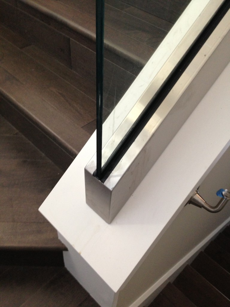 Custom Stainless Steel Cladding on Glass Stair Guardrail that covers CRL Aluminum Rail Base Shoe
