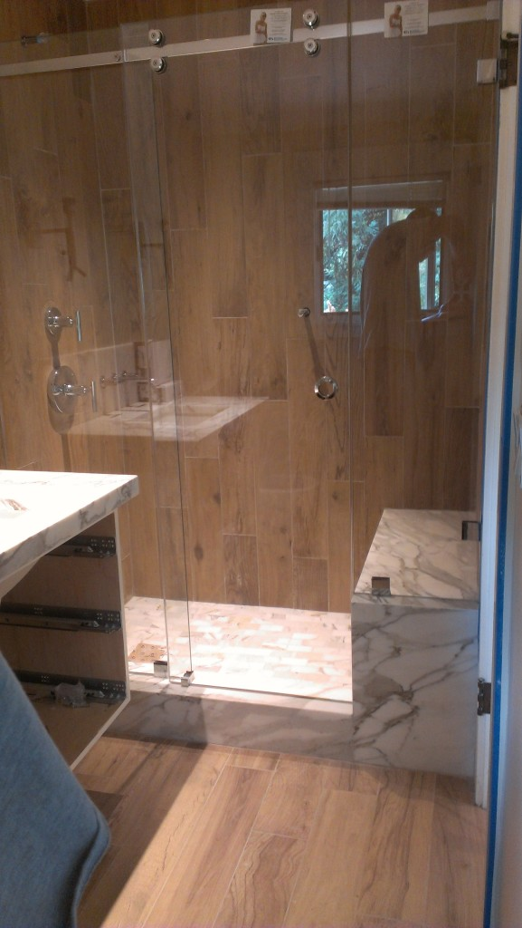 CRL's Serenity Heavy Glass Shower with Polished Chrome Hardware.  Features SCU4 Clamps and a Handle Drilled Through the Glass