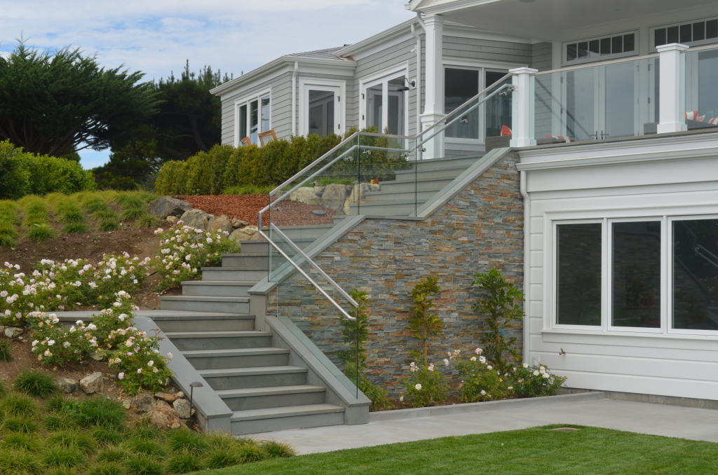 Shows an overview of a base shoe glass railing used in a stair in Tiburon, CA.