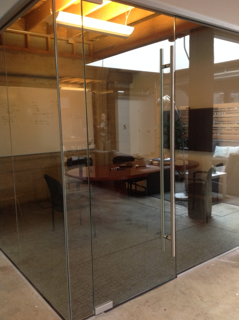 Glass Conference Room with a Glass Corner and Stainless Steel Ladder Pull