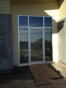Clear Anodized All Weather, 7000 Series Door Frame with Inswing Center Operable Panel