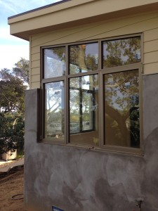All Weather Custom Casement Assembly with Pitched Fixed Windows Above