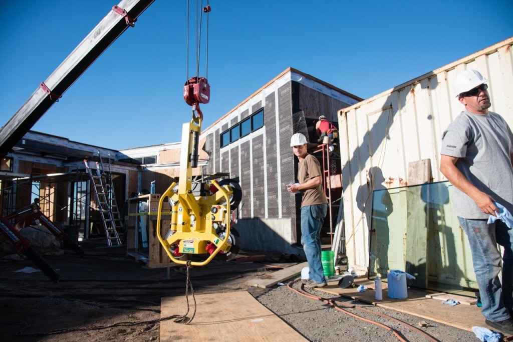 Old Town Glass Installation Crew using Spydercrane and Suction Cups to Set Glass on a Sea Ranch Project.
