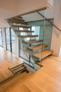 Custom tempered glass panels in the interior stairwell